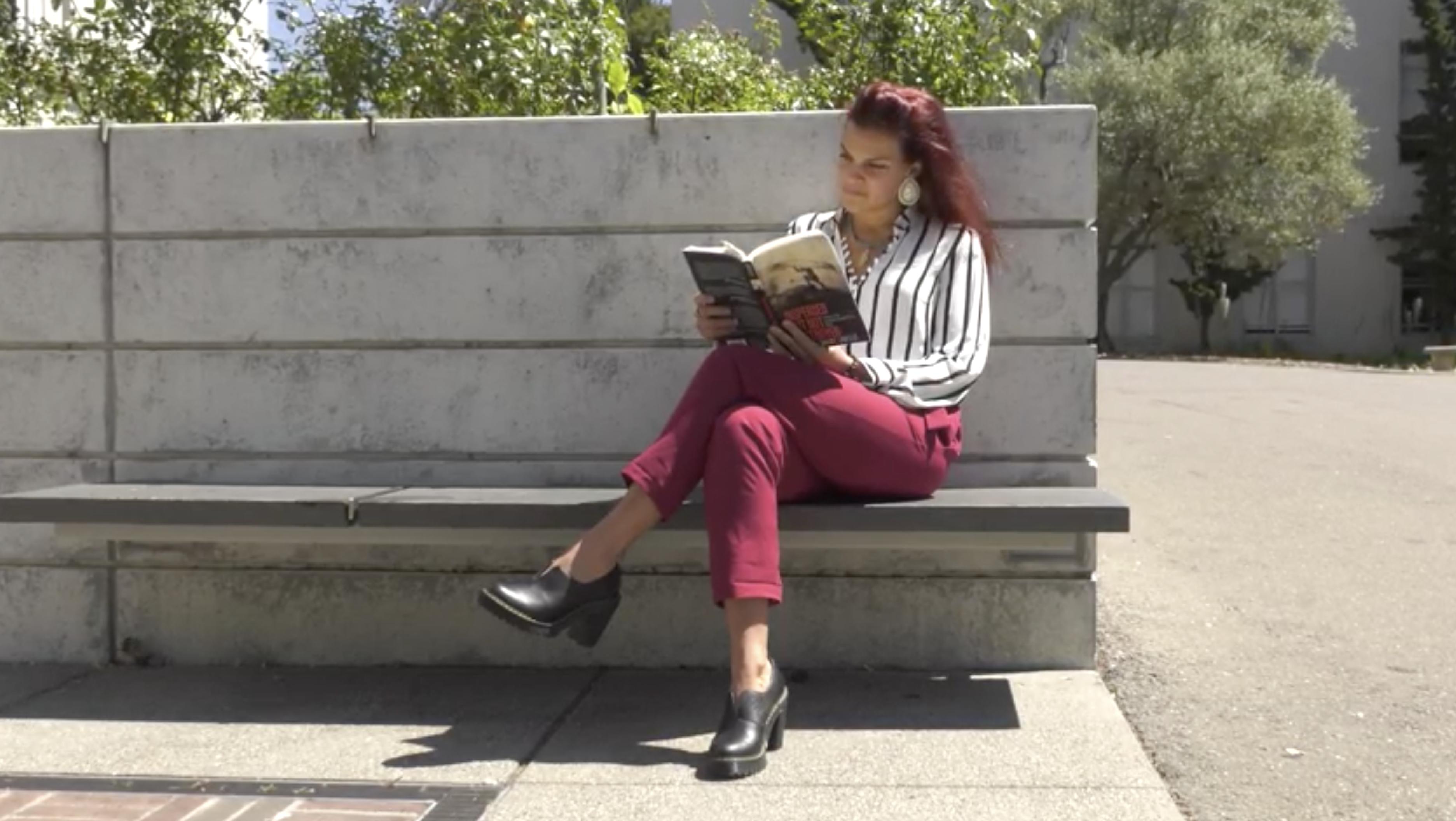 Fallon reading a book outside.